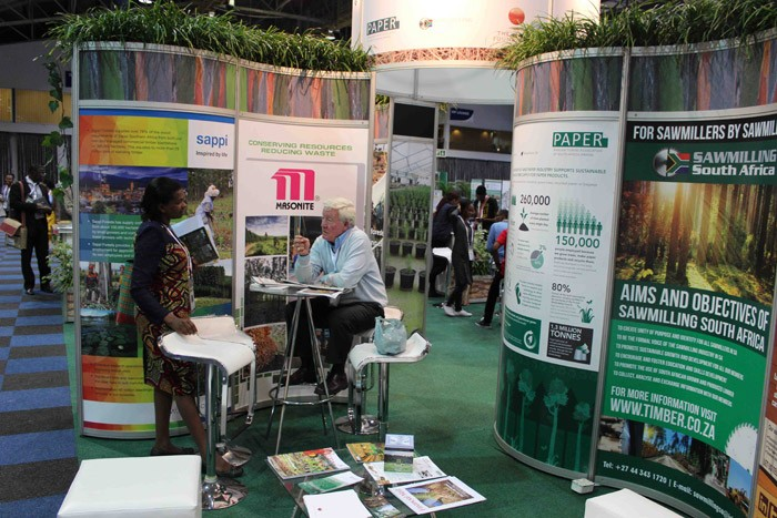 Former CEO of Forestry South Africa, Mike Edwards, chats to a delegate at the combined South African forestry exhibition stand at the WFC.